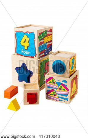 Cubes Sorter. The Material Is Wood. Educational Toy Montessori. White Background. Close-up.