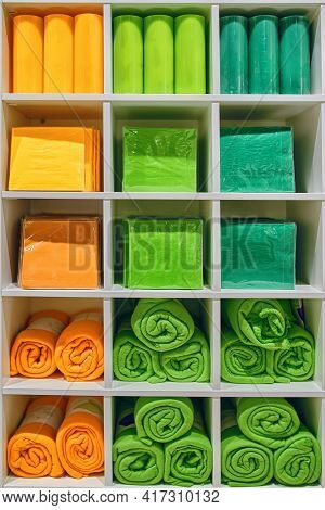 Paper Napkins Candles And Blankets For Sale In Shelf Of Interior Decorating Store. Aromatic Paraffin