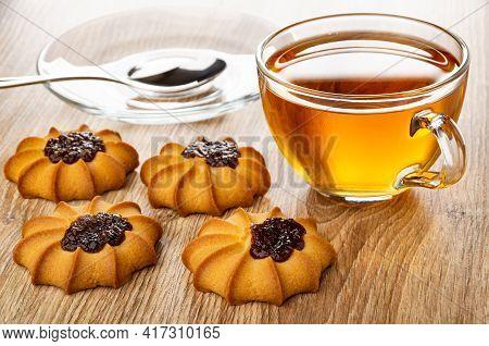 Teaspoon In Glass Saucer, Few Kurabiye With Jam, Tea In Transparent Cup On Saucer On Wooden Table