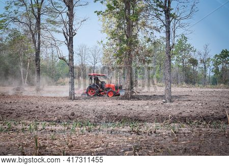 Tractor On The Field Sowing Planting Seeds Mechanization, Farmer In Tractor Preparing Land And Plow