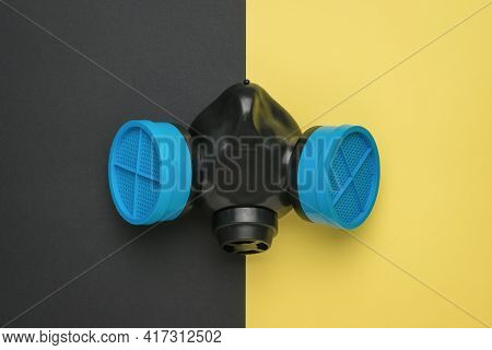 Gas Mask With Blue Filters On A Two-color Background. Respiratory Protection.