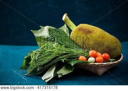 Young Jackfruit And Local Vegetables In A Basket On Color Background, Food Ingredients For Northern