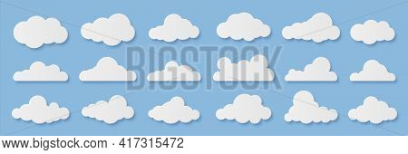 Clouds. Cartoon Rainy Sky. Paper Cut Decorative Cloudy Forms. Fluffy Shapes On Blue Background. Orig