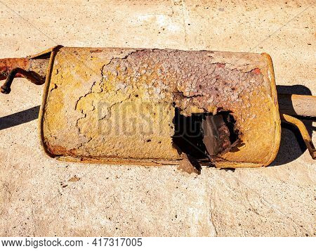 Old Rusty Car Muffler With A Burnt Hole. Exhaust System Of The Car. Auto Muffler. Vehicle. Vehicle S