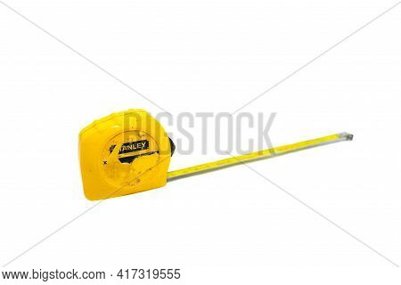 Miercurea Ciuc, Romania- 18 April 2021: Old, Used Stanley Tape Measurer Isolated On White Background