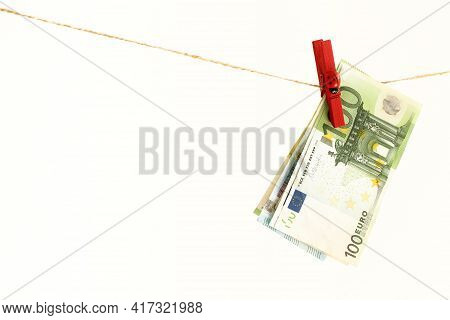 Paper Euro Bills On A Red Clothespin Dry After Washing, Ladybug On A Wooden Clothespin