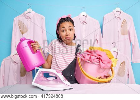 Hesitant Clueless Housewife With Dreadlocks Shrugs Shoulders Doesnt Know What To Do First Stands Nea