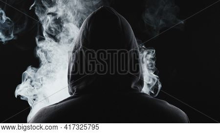 Photo Of Smoker In The Hood From Back