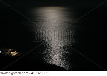 Moonlit Path In The Sea. Full Moon Over The Sea On A Dark Night.