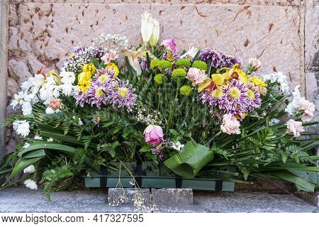 Bouquet Of Flowers On The Old Wall Of The Ancient Church