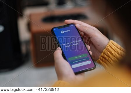 Chiang Mai , Thailand Apr 14 2021 : Apple Iphone Xs Smartphone With Spotify App On Screen.spotify Is