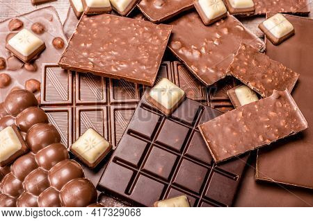 Top View Of Arrangement Of Various Types Of Chocolate. Delicious Chocolate Mix. Top View Of Pieces O