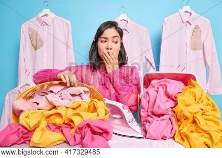 Stunned Speechless Brunette Asian Woman Covers Mouth Busy Working Has Daily Work Poses At Ironing Bo