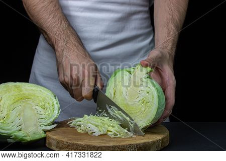 Cabbage On A Dark Background. Shred Cabbage Chef On Black Background. Young Fresh Cabbage. Healthy D