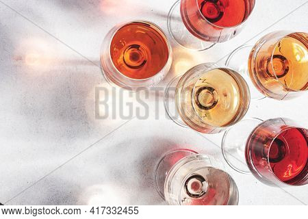 Rose Wine Glass On Gray Table. Pink Rosado, Rosato Or Blush Wine Tasting In Wineshop, Bar Concept. C
