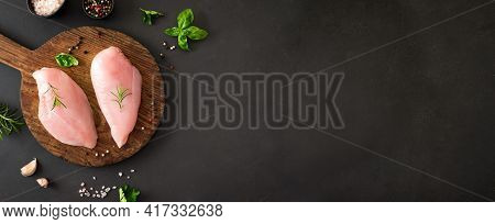 Fresh Raw Chicken Breast Fillet With Herbs And Spices On Wooden Board, Banner, Copy Space. Chicken O