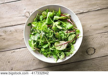 Healthy Green Salad, Fresh Organic Leaves Mix Salad With Arugula, Swiss Chard And Lettuce, Wooden Ba
