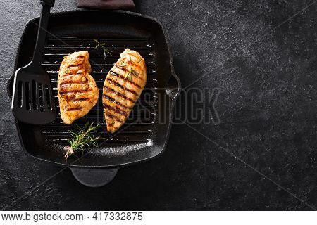 Grilled Chicken Breast Fillet On Grill Pan With Rosemary, Top View, Copy Space. Grilled Meat Steak O