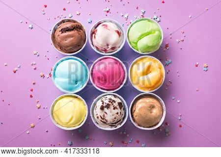 Ice Cream Assortment. Various Ice Creams Or Gelato On Purple Background, Copy Space. Frozen Yogurt
