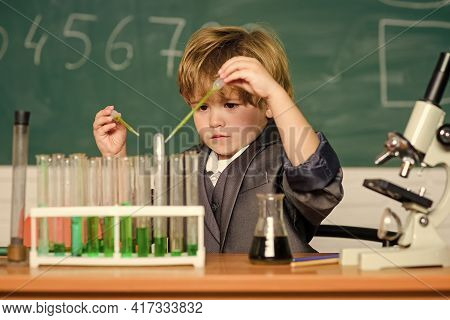 Genius Pupil. Education Concept. Wunderkind Experimenting With Chemistry. Boy Test Tubes Liquids Che