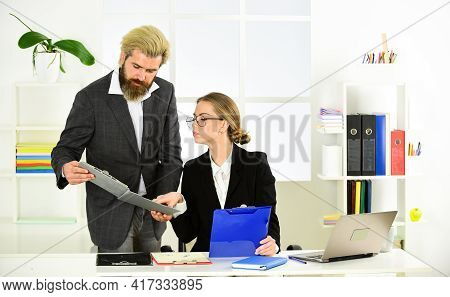Stressful Day At The Office. Male Boss With His Secretary. Office Couple Discuss Business. Modern Of