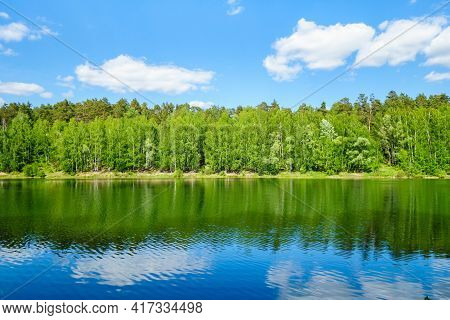 Summer Forest, Reflecting In Waters Of Lake Or River. Corner Of Virgin Nature, Untouched By Human Ac