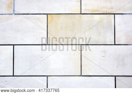 Background From A Wall With Rectangular White Stone Slabs