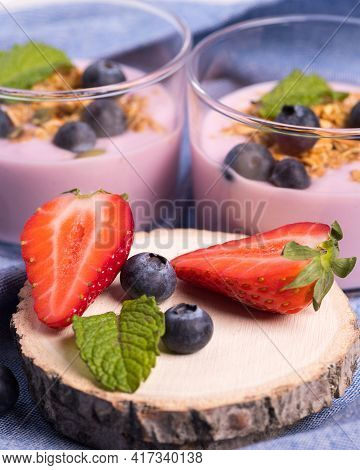 Close Up Of A Healthy Breakfast Made With Blueberries, Strawberries And Cereals With Creamy Yogurt.