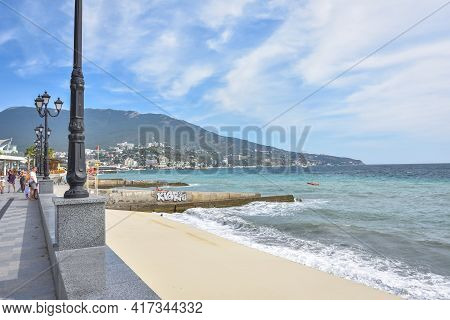 Yalta, Russia - September 13, 2020: Embankment In The Resort Town Of Yalta, People Walk Along The Ya
