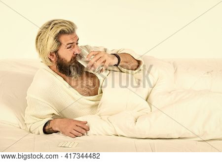 Hipster Drink Water Take Medicines. Headache Hangover. Hangover Remedy. Hangover Concept. Man Painfu