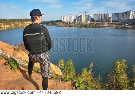 A Man On A Hill Looks At The Lake, A Man From The Back