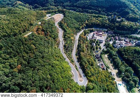 Winding Road Serpentine From A High Mountain Pass In The Rhine Village Bendorf Sayn Germany Aerial V