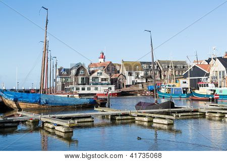 Historic Dutch harbor of Urk with lighthouse and old shipyard poster
