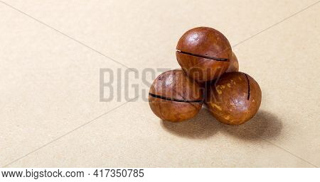 Macadamia Nuts Bunch Of Ripe Nutritious Proteins In A Ripe Harvest On A Brown Background Food For Ve