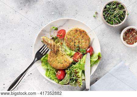 Green Broccoli And Quinoa Burgers On Gray Table
