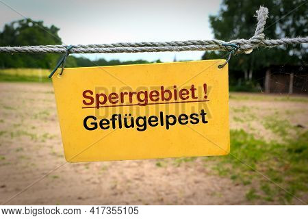 Sign At The Entrance Of A Farm In Germany With The Inscription Restricted Area Avian Influenza (sper