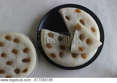 Spongy Steamed Rice Cakes Prepared With A Fermented Batter Of Rice And Coconut, Sweetened With Sugar