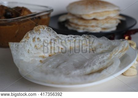 Hoppers And Rice Pancakes. Two Types Of Red Rice Breakfast Dishes Along With Chicken Curry Made With