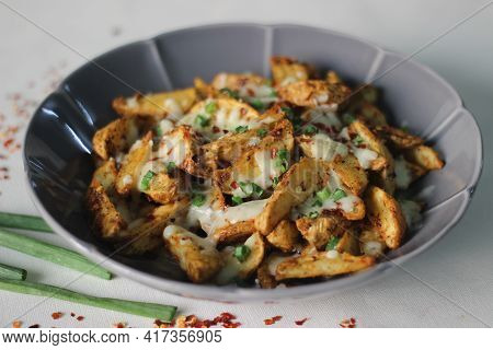Cheesy Potato Wedges Made By Baking Air Fried Potato Wedges After Sprinkling It With Shredded Mozzar
