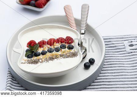 Fresh Yogurt With Fruits, Granola, Chia Seeds Und Napkin