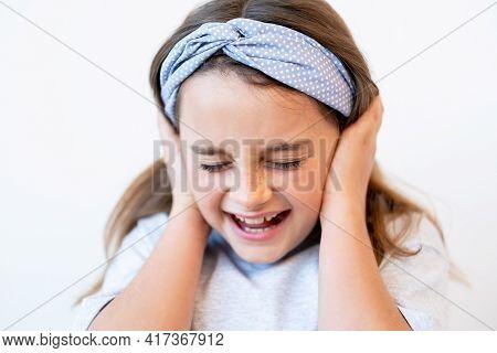 Disobedient Kid. Child Discipline. Temper Tantrum. Portrait Of Naughty Disturbed Anxious Small Girl