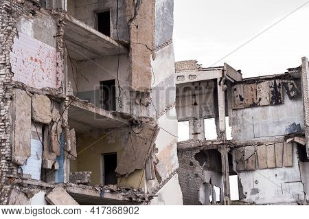 The Remains Of The Walls Of A Destroyed Concrete Building. Background