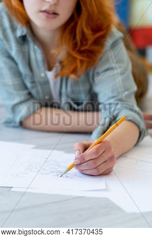 Drawing Hobby. Art School. Creative Skill Talent. Left-handed Red-haired Female Artist Sketching Wit