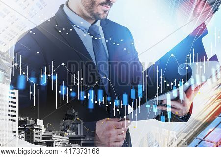 Businessman Or Trader Looking Into The Weekly Report Of Stock Market Changes, Business Candlesticks