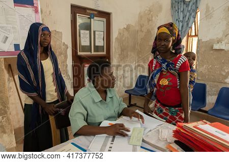 Dodoma, Tanzania. 10-10-2018. Black Muslim Staff From A Rural Hospital Are Working At The Entrance O