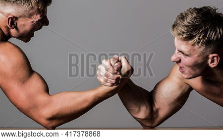 Arm Wrestling. Two Men Arm Wrestling. Rivalry, Closeup Of Male Arm Wrestling. Two Hands. Men Measuri