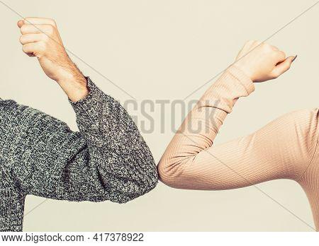 Elbows Bump. Health Care Concept. Social Distancing. Two People Bump Elbows To Avoid Coronavirus. Co