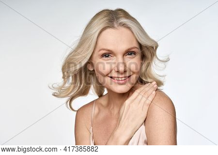 Happy Smiling Adult 50s Aged Woman Looking At Camera With Hand On Her Shoulder Portrait Isolated On