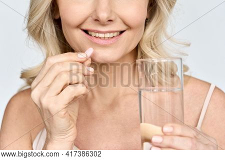 Crop Closeup Portrait Of Smiling Happy Middle Age Woman With Glass Of Water And Vitamins Collagen Ca