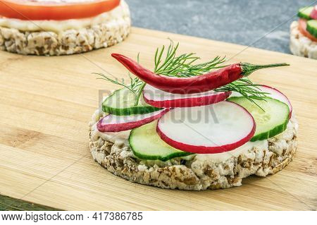 Sandwich Of Diet Bread With Slices Of Radish Cucumber Red Pepper And Melted Cheese On Wooden Cutting